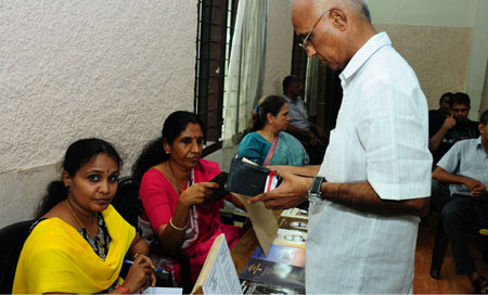 At sale counter of books and CD - Ms Lata Devan, Lalitha Harikumar and Susheela Madhavan